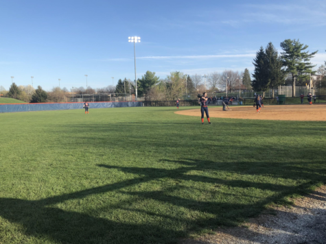 Players warm-up in between the third and fourth inning on March 26, 2018. Hershey was still in the lead against Bishop McDevitt at 3-2. (Broadcaster/Abbey Rogers)
