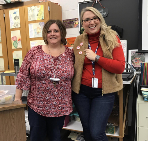 HHS Spanish teacher Mrs. Clouser and Mrs.Ives support the third day of SADD's Red Ribbon Week. The HHS teachers wore red to show their resistance against drugs. (Broadcaster/Tori Moss)