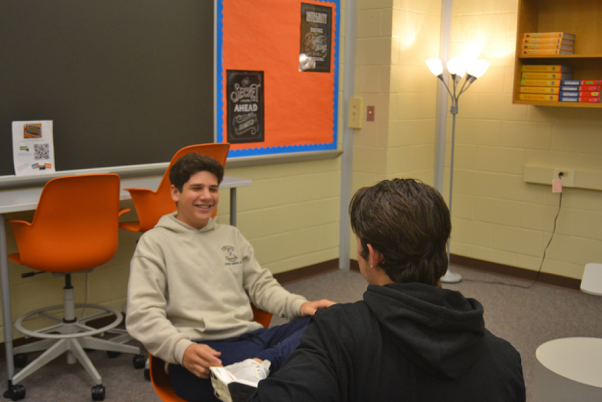 Sophomores Luca Correll and Niko Lilla collaborating in the Blended Learning Lounge. The Blended Learning Lounge is available for students to complete classwork or work together with their peers. (Broadcaster/Emma Quillen)