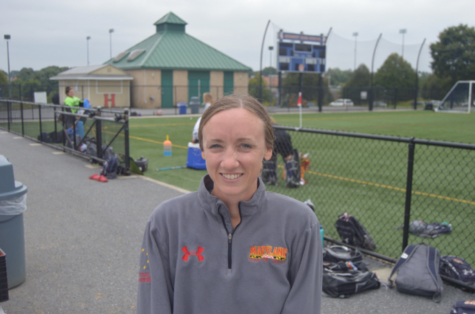 """The head coach, Brianna Price, poses for a picture near the field on September 21, 2018. Price said """"I love coaching high school age girls."""" (Broadcaster/Abbey Rogers)"""