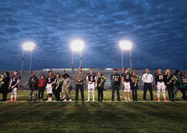 HHS football players stand with their friends and family on Senior Night. Hershey would go on to lose the game 42-25 to Lower Dauphin. (Broadcaster/Kate Clark)