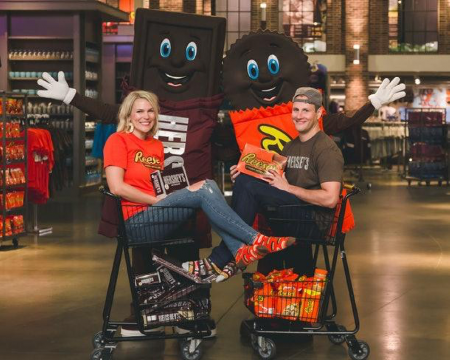 Jenny Ries and Craig Hierschey pose along with the Hershey's and Reese's mascot at Chocolate World located in Hershey, PA. The new milk chocolate bar Reese's Pieces combo will hit US stores in November. (The Hershey Company)