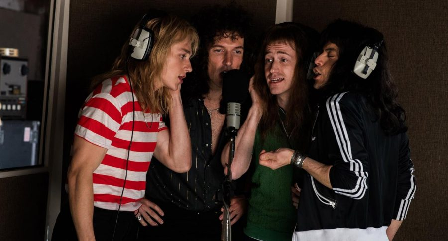 Pictured are Queen's four members recording the song that is the movie's namesake, Bohemian Rhapsody. Shown from left to right is Roger Taylor (Ben Hardy), Brian May (Gwilym Lee), John Deacon (Joseph Mazzello), and Freddie Mercury (Rami Malek). (Fox Movies)