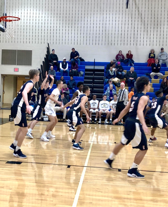 The Trojans defend the basket against the Crusaders. Previously, on December 18, the Trojans lost to McDevitt with a score of 31-62. (Broadcaster/Clare Canavan)