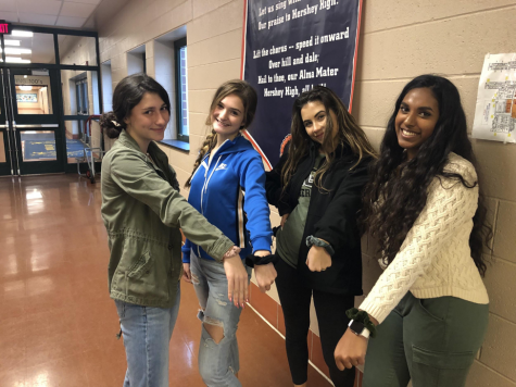 (left to right:)Sophomores Catie Reilly, Keeley Farrell, Lucy Farmen, and Junior Manisha Kodavatiganti pose in the HHS cafeteria with their scrunchies. They all usually wear scrunchies to school. (Ashlyn Weidman/ The Broadcaster)