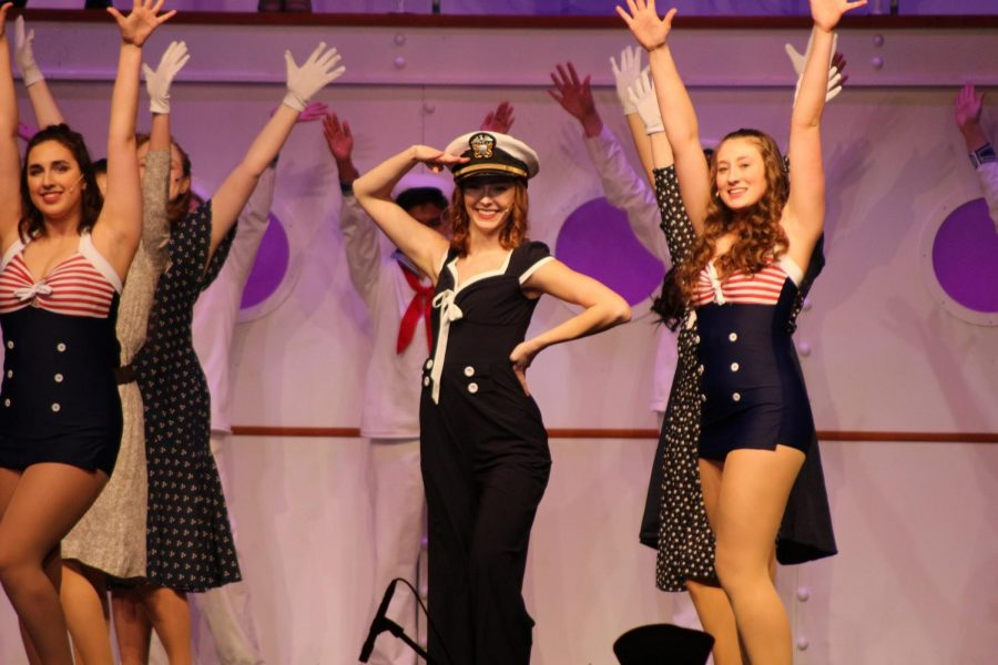 "Seniors Karis Gould (left) and Myah Koepfer (middle) sing and dance along with freshman Hattie Gavazzi (right) during the HHS musical preview on Wednesday, February 27th. In 2011, the production, ""Anything Goes,"" received ten Drama Desk Award nominations. (Broadcaster/Elena Lee)"