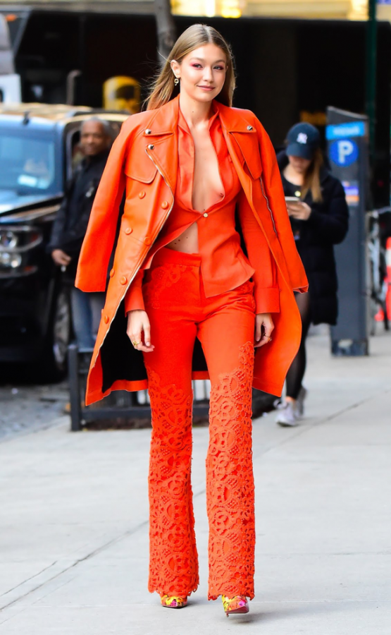 Gigi Hadid walking the streets of New York in a full coral outfit. Hadid wore this outfit the day after Pantone announced the color of the year. (Vogue)
