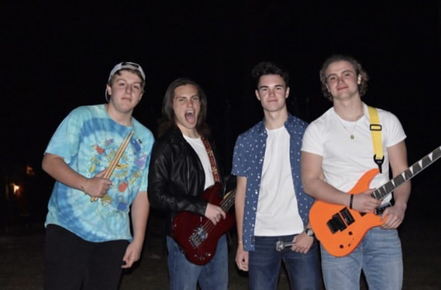 From Left to Right, Jacob Drexler, Luke Sheppard, David Randall, and Anthony Zimmerman pose after a long practice before their debut performance as Saguaro. Because of the success of the talent show, the band plans to perform at many other events around the Hershey community. (Michelle Sheppard)