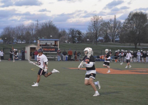 HHS junior Jay Rodriguez (left) plays defense on a Palmyra attacker. The Trojans fell to the Cougars with a score of 11-4. (The Broadcaster/Leah Koppenhaver)