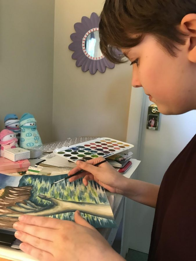 Sophomore Emily Farr works on her latest watercolor piece on May 15, 2019. The piece was part of an English assignment to illustrate the essence of the F. Scott Fitzgerald novel The Great Gatsby. (Broadcaster/Té Burkholder)