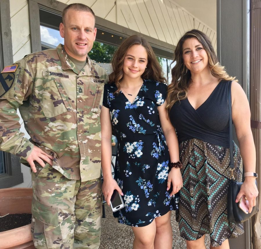 Maddie Smith poses with her mother and father on May 20th, 2018. Her father has moved multiple times for his military position and the family has followed. (Broadcaster/Mia Bertoldi)