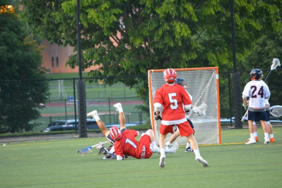 Midfielder Jay Rodriguez collides with a Susquehannock player in the final minutes of their game on May 16, 2019.  Hershey won 10-6. (Broadcaster/Caroline Glus)