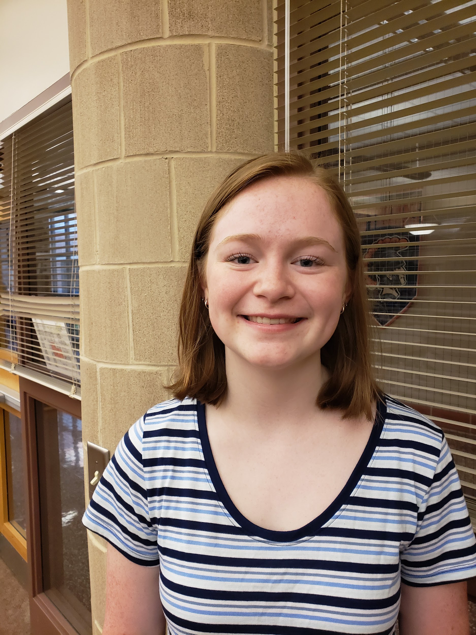 Lola Berra poses in the library on the morning of May 29th, 2019. Berra spends her mornings before class in the library where she spends time with her friends. (Broadcaster/Talon Smith)