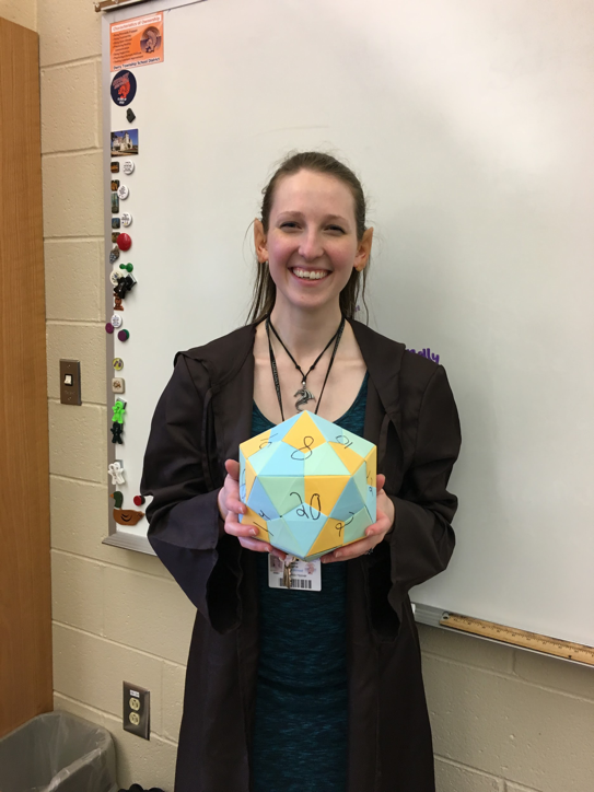 HHS chemistry teacher and Dungeons and Dragons club advisor Emily Hoover smiles for a photo on May 20, 2019. The club held its last meeting for the school year that day and had a party to celebrate. (Broadcaster/Abigail Lee)
