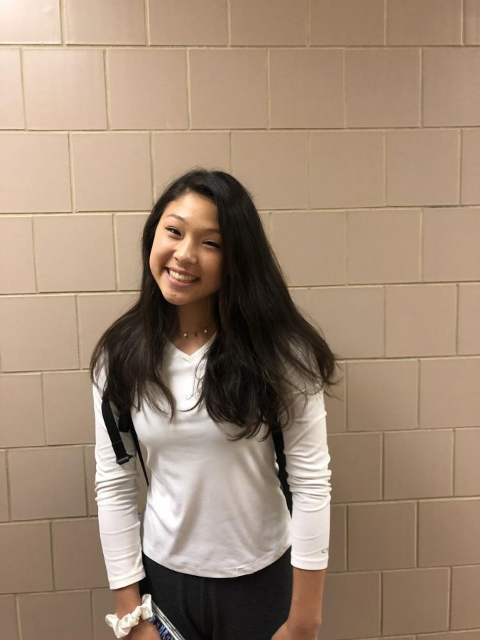 Ella Ferns smiles for the camera in the halls of HHS on May 14, 2019. She just left one of her favorite classes, health. (Broadcaster/Anika Hosenfeld)