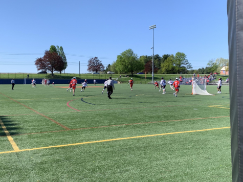 Hershey in white defends against the Wilson offense on 4/27/19.  Hershey's Colin Kondracki scored four goals in the 10-5 loss. (Broadcaster/Adrianna Malena)