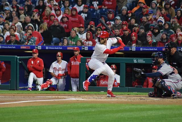 Bryce Harper takes a swing during one of his first games in a Phillies uniform on March 31. Harper signed a 13-year contract to land in Philadelphia. (Ian D'Andrea/Flickr, CC BY-SA 2.0)