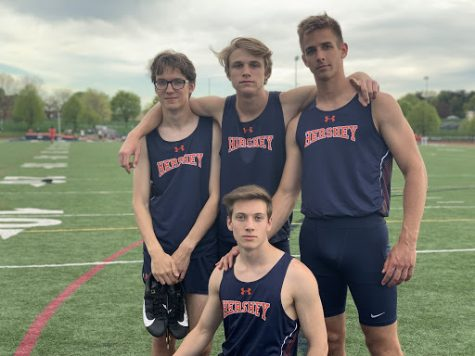 Seniors Mark Suminski (right), Alex Elchev (left), and Chris Cronin (bottom center) stand with teammate Ian Willen during track meet on Tuesday, April 24th. Hershey High Boys Track beat Susquehanna 78 to 72. (Broadcaster/ Emily Massage)