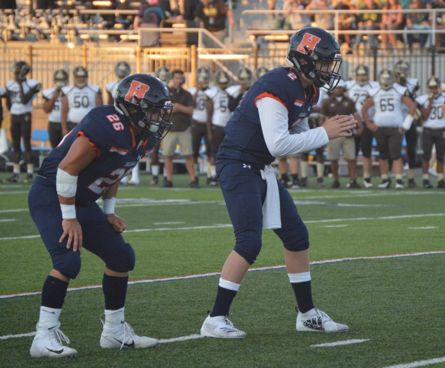 HHS juniors Jackson Boslough and Nathan Lopez awaiting the snap during the 77th annual Cocoa Bean game on Friday, September 6th. Boslough attempted 18 passes and completed five passes for a total of 72 yards while Lopez rushed five times for a total of 16 yards.  (Broadcaster/Joshua Gearhart)