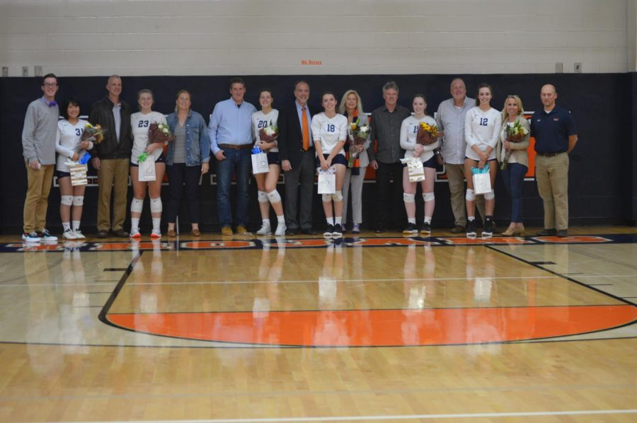 The six volleyball seniors stand with their parents and coaches. The girls played their last high school volleyball game following senior night on October 17, 2019 at Milton Hershey High School. (Broadcaster Claire Sheppard)