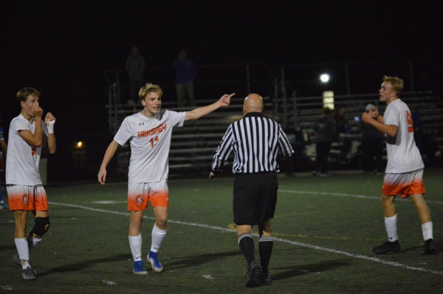 Junior Austin Kerr debates a call with the referee on October 28, 2019. Elliot Stalebrink scored in the last few seconds of the half, but the referee called no-goal due to time expiring. (Broadcaster/Mallory Gillespie)