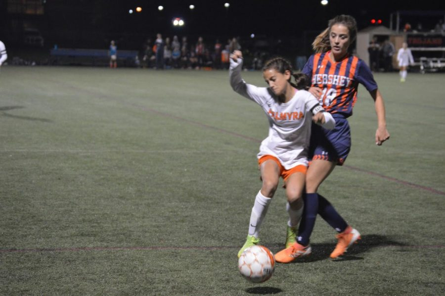 Senior Abby Wilson pressures Palmyra's captain for the ball on Tuesday, Oct. 8. The game resulted in a double overtime with a final score of 0-0. (Broadcaster/Katie Jones)