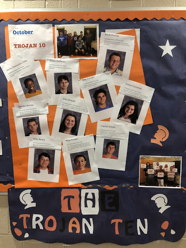 Photos of the October Trojan Ten are displayed outside of the cafeteria and includes why they were nominated. These students were nominated by Hershey High School teachers who noticed they were positively impacting the school community. (Broadcaster/Leah Koppenhaver)