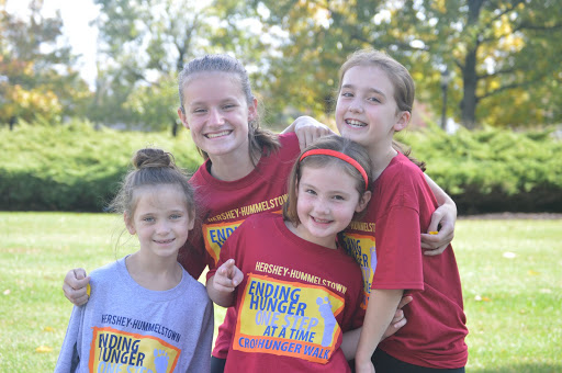 (From left to right) Grace Backenstone, Emma Taylor, Ellie Steelman, and Katie Steelman pose together right before the CROP Walk started. The team that raised the most amount of money this year was the Grand Canyon walkers. (Broadcaster/Natalie Taylor)