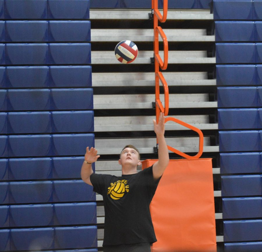 Sophomore, Zach Miller, serves for his team attempting to score a point in the match. (Broadcaster/Julia Cream)