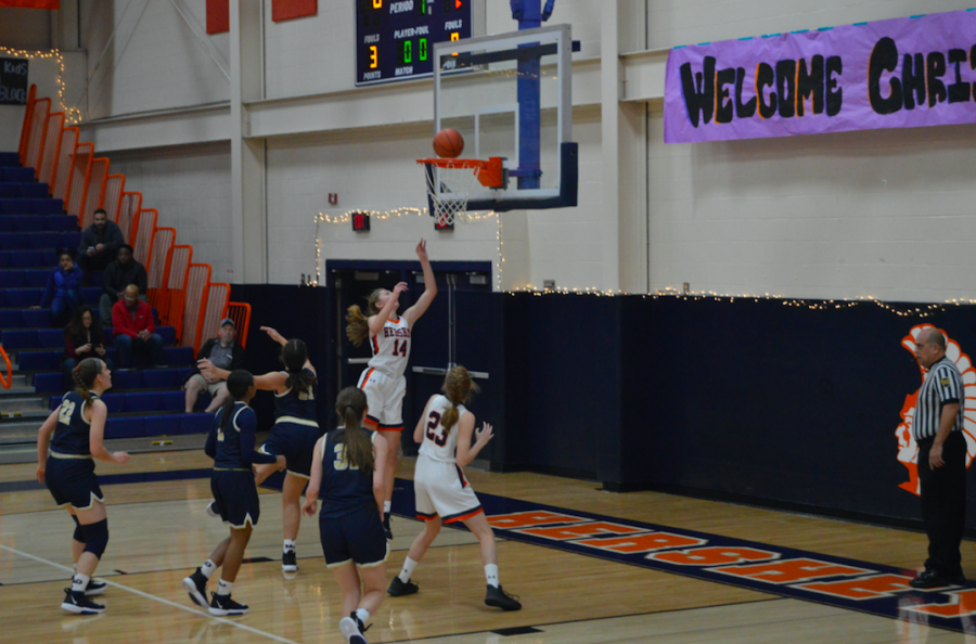 Sophomore Anna Coulter shoots a lay up in the beginning of the game. The Trojans were winning the game after the first quarter of play. (Broadcaster/Katie Jones)