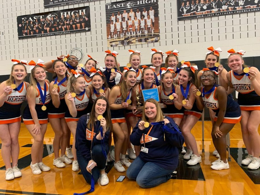 """The competitive cheer team is captured enjoying the moments after their first place announcement. The cheerleaders referred to themselves as """"the underdogs"""" and still came out on top of their first competition. (Submitted by Katie Canavan)"""