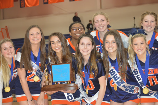 Members+of+the+Hershey+cheer+team+pose+with+their+district+championship+trophy+on+Tuesday%2C+February+4th+2019.+The+cheer+team+was+honored+for+their+accomplishment+at+the+Hershey+vs+LD+basketball+game.+%28Broadcaster%2FAshlyn+Weidman%29