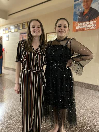 Sophomore+Emma+Taylor+%28left%29+and+freshman+Camryn+Yingling+%28right%29+show+off+their+contrasting+yet+complementary+styles.+Taylor%E2%80%99s+jumpsuit+is+from+Target%2C+and+Yingling%E2%80%99s+dress+is+from+Romwe.+%28Broadcaster%2FNatalie+Taylor%29