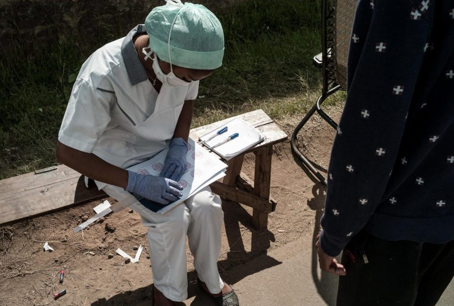 A healthcare worker in Madagascar documents a COVID-19 test on March 26, 2020.  The rumor of testing a vaccine in an African country is false, but multiple trials of the vaccine have begun around the world.  (World Bank /Henitsoa Rafalia)
