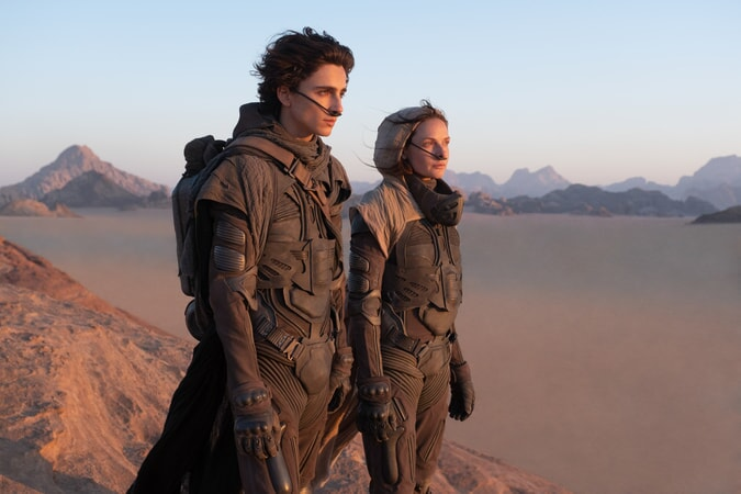(Left to Right) Timothee Chalamet and Rebecca Ferguson posing for a photo while looking off into the distance. In the film Ferguson played Chalamet's mother in her leading role of Lady Jessica. (Warner Bros.)
