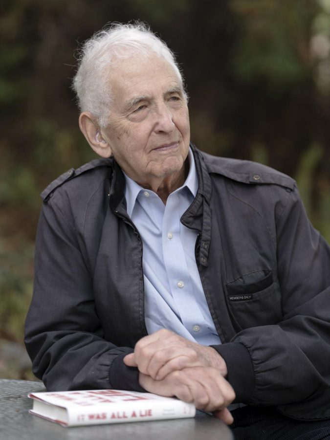 """Daniel Ellsberg poses with a copy of """"It was all a lie"""" by Stuart Stevens in 2020.  Ellsberg is credited with leaking the Pentagon Papers to reporters. (Christopher Michel/CC BY 2.0)"""