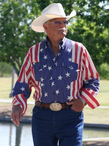 An older gentleman participates in the VisionWalk in Arizona in 2012.  While wearing the American flag is a violation of the Flag Code, it is not enforceable by law. (cobalt123/CC BY-NC-SA 2.0)