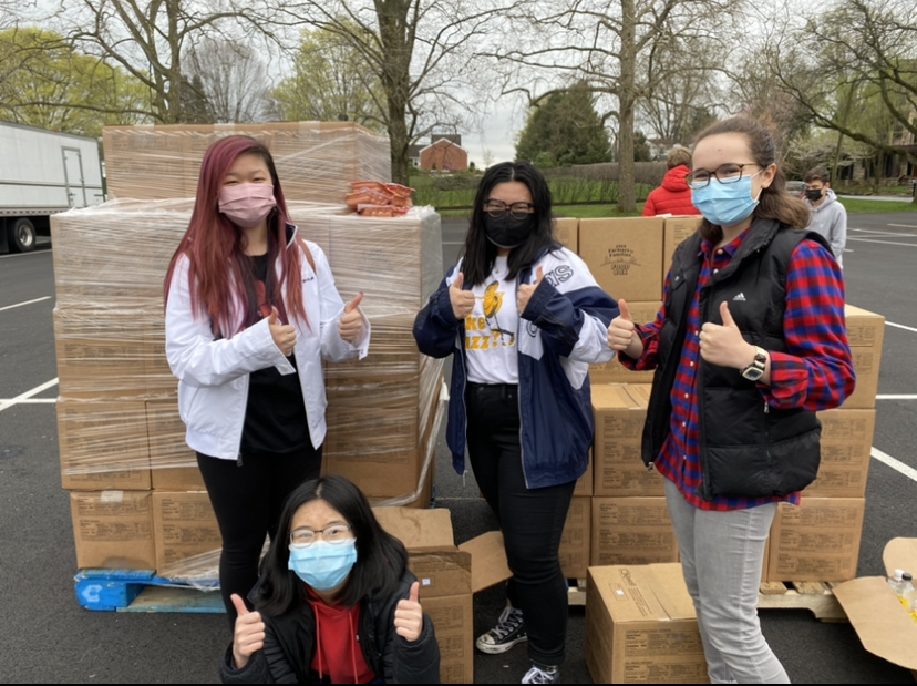 Seniors Joyce Cui, Nicole Chen, Lauren Kaye and sophomore Irena Potochny pose for a photo at the Spring Creek Church. Chen volunteered during the afternoon shift and Cui, Kaye, and Potochny volunteered during the evening shift. (Broadcaster/Abigail Lee)