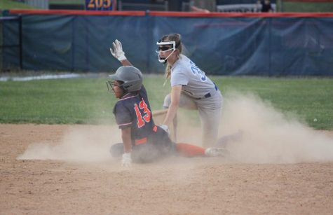 Center fielder, Adrianna Malena, slides to second base.  The umpire called her safe. (Broadcaster/Roma Orris)